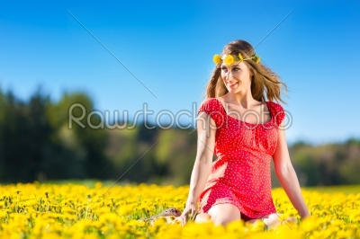 stock photo: girl in spring on a flower meadow with dandelion-Raw Stock Photo ID: 45022