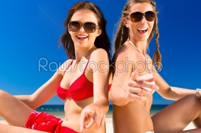 stock photo: girls enjoying freedom on the beach-Raw Stock Photo ID: 45621