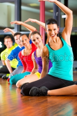stock photo: group of people and instructor in gym stretching-Raw Stock Photo ID: 47198