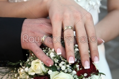 stock photo: hands and rings on wedding bouquet-Raw Stock Photo ID: 28388