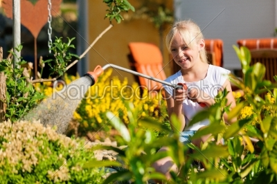 stock photo: happy child watering flowers-Raw Stock Photo ID: 42148