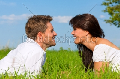 stock photo: happy couple lying on a meadow-Raw Stock Photo ID: 42386