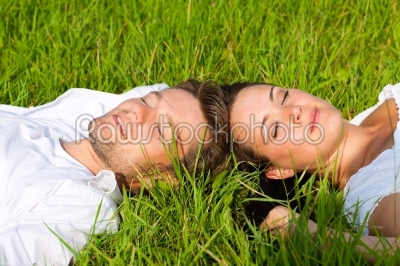 stock photo: happy couple lying on a meadow-Raw Stock Photo ID: 42389