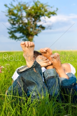 stock photo: happy couple lying on a meadow-Raw Stock Photo ID: 42401