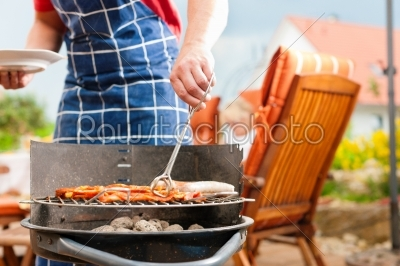 stock photo: happy family having a barbecue-Raw Stock Photo ID: 42187