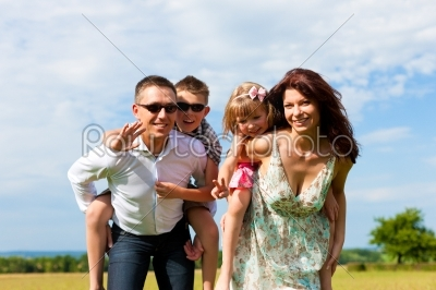 stock photo: happy family on a meadow in summer-Raw Stock Photo ID: 42421