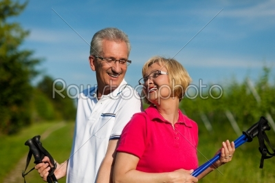 stock photo: happy mature or senior couple doing nordic walking in summer-Raw Stock Photo ID: 42222