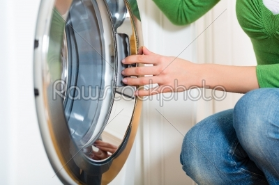 stock photo: housekeeper with washing machine-Raw Stock Photo ID: 47931