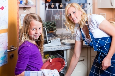 stock photo: housewife and daughter doing dishes with dishwasher-Raw Stock Photo ID: 44763