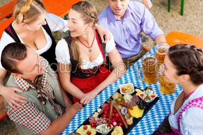 stock photo: in beer garden  friends on a table with beer-Raw Stock Photo ID: 42002
