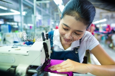 stock photo: indonesian seamstress in a textile factory-Raw Stock Photo ID: 47400
