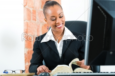 stock photo: lawyer in office with law book and computer-Raw Stock Photo ID: 47795