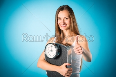 stock photo: losing weight  young woman with measuring scale-Raw Stock Photo ID: 46797