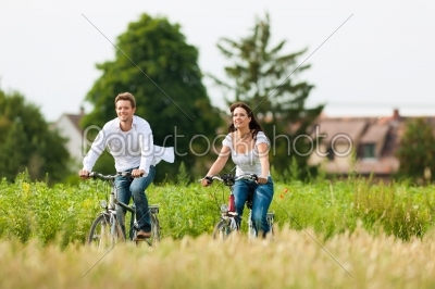 stock photo: man and woman cycling in summer-Raw Stock Photo ID: 42365