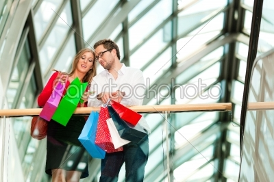 stock photo: man and woman in shopping mall with bags-Raw Stock Photo ID: 40245