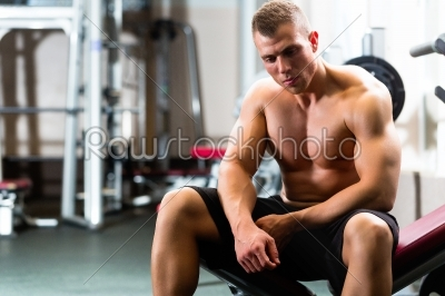 stock photo: man in gym or fitness studio on weight bench-Raw Stock Photo ID: 46540
