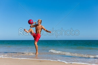 stock photo: man on beach playing soccer-Raw Stock Photo ID: 40281
