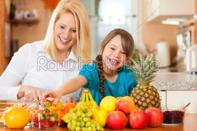 stock photo: mother and child with lots of fruits-Raw Stock Photo ID: 41374