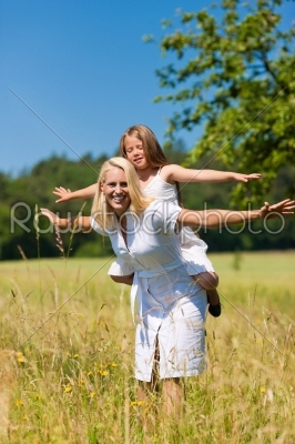 stock photo: mother with daughter in meadow-Raw Stock Photo ID: 42172