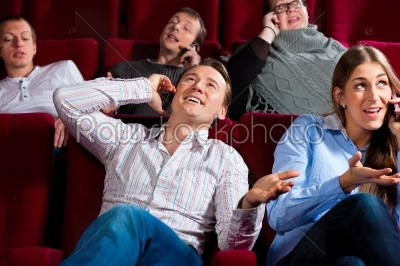 stock photo: people in cinema theater with mobile phone-Raw Stock Photo ID: 41332