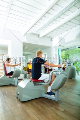 stock photo: people in sport gym on machines-Raw Stock Photo ID: 45496