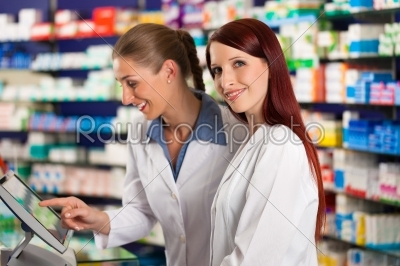 stock photo: pharmacist with assistant in pharmacy-Raw Stock Photo ID: 40656
