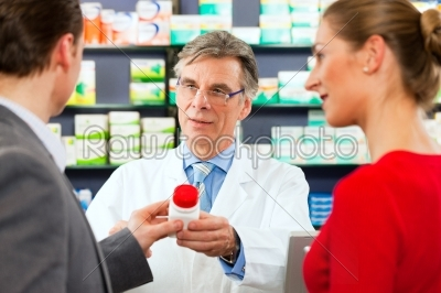 stock photo: pharmacist with customers in pharmacy-Raw Stock Photo ID: 41143