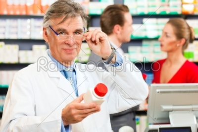 stock photo: pharmacist with customers in pharmacy-Raw Stock Photo ID: 41150