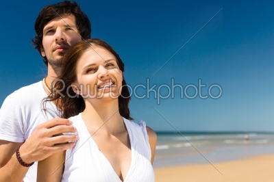 stock photo: playful couple on the ocean beach enjoying their summer vacation he embraces her-Raw Stock Photo ID: 45644