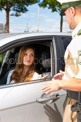 stock photo: police  woman in traffic violation getting ticket-Raw Stock Photo ID: 45947