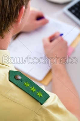 stock photo: police officer working on desk in station-Raw Stock Photo ID: 48078