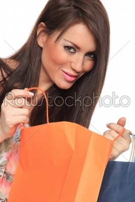 stock photo: portrait of stunning young woman carrying shopping bags-Raw Stock Photo ID: 13594
