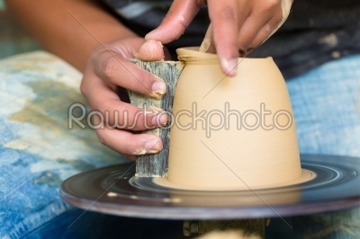 stock photo: potter creating clay bowl on turning wheel-Raw Stock Photo ID: 47267