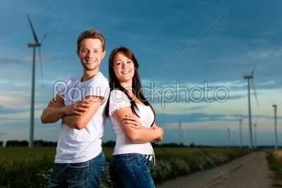 stock photo: powerful couple in front of windmill -Raw Stock Photo ID: 42409
