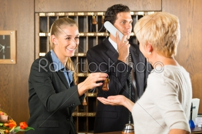stock photo: reception  guest checking in a hotel-Raw Stock Photo ID: 46425