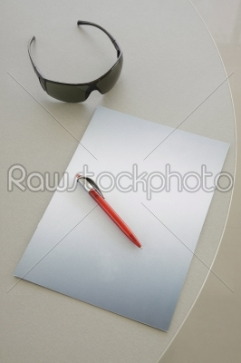 stock photo: red pen on a grey notebook -Raw Stock Photo ID: 9805