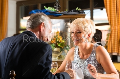 stock photo: senior couple fine dining in restaurant-Raw Stock Photo ID: 46417