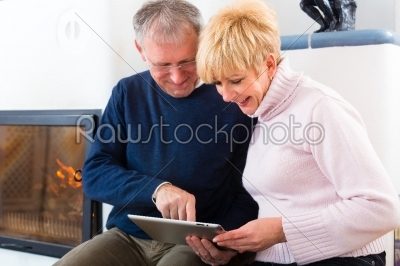 stock photo: seniors at home in front of fireplace-Raw Stock Photo ID: 47830