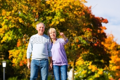 stock photo: seniors in autumn or fall walking hand in hand-Raw Stock Photo ID: 46518