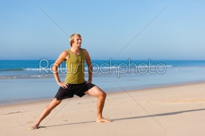 stock photo: sportive man doing gymnastics on the beach-Raw Stock Photo ID: 40261