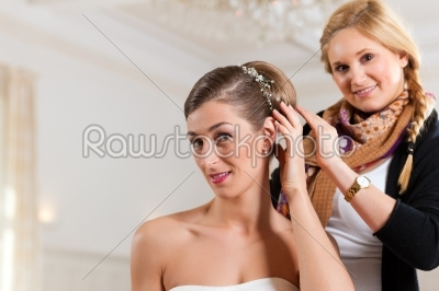 stock photo: stylist pinning up a brides hairstyle-Raw Stock Photo ID: 41669
