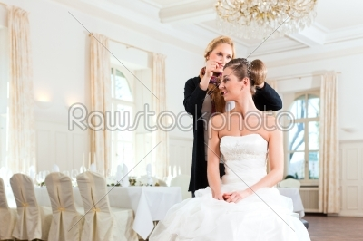 stock photo: stylist pinning up a brides hairstyle-Raw Stock Photo ID: 41670