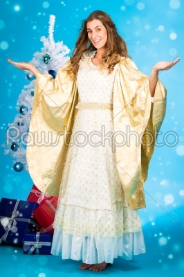 stock photo: traditional christmas angel in front of tree-Raw Stock Photo ID: 43476