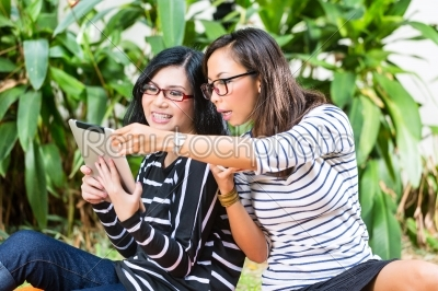 stock photo: two asian girlfriends with tablet computer-Raw Stock Photo ID: 45525