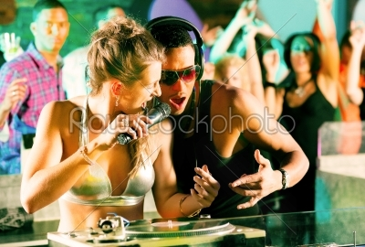 stock photo: two djs at the turntable in club-Raw Stock Photo ID: 40366