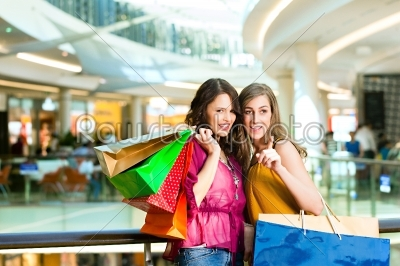 stock photo: two female friends shopping in a mall-Raw Stock Photo ID: 44246