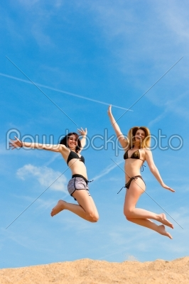 stock photo: two happy women jumping high with fun-Raw Stock Photo ID: 42240