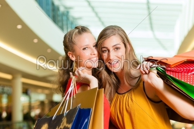 stock photo: two women shopping with bags in mall-Raw Stock Photo ID: 44238