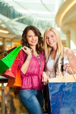 stock photo: two women shopping with bags in mall-Raw Stock Photo ID: 44244