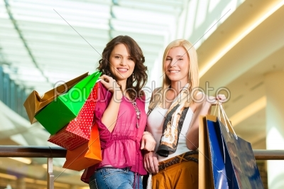 stock photo: two women shopping with bags in mall-Raw Stock Photo ID: 44245